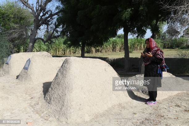 This photograph taken on September 27 shows Pakistani woman Mukhtiar Naz known as Waderi Nazo Dharejo offering pray at the graves of her relatives in...