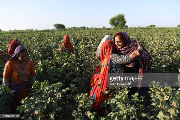 This photograph taken on September 27 shows Pakistani woman Mukhtiar Naz known as Waderi Nazo Dharejo meeting with her workers at her agriculture...