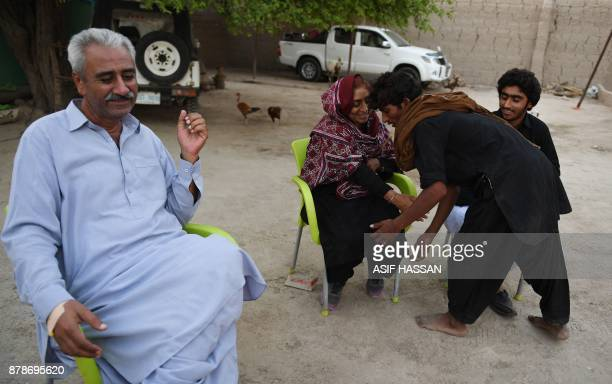 This photograph taken on September 27 shows Pakistani woman Mukhtiar Naz known as Waderi Nazo Dharejo and her husband Zulfiqar Dharejo meeting with...
