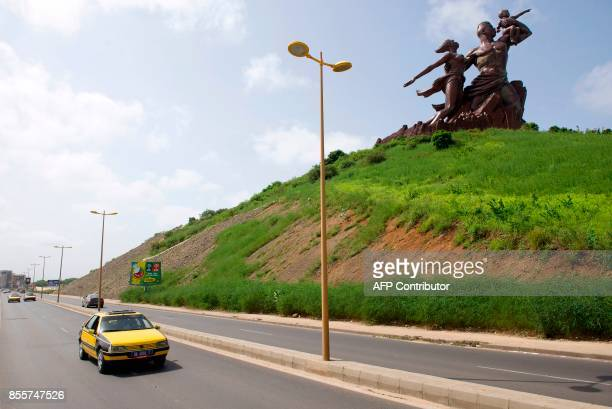 This photograph taken on September 27 shows The Monument of the African Renaissance which sits on a volcanic hill overlooking Dakar the capital of...