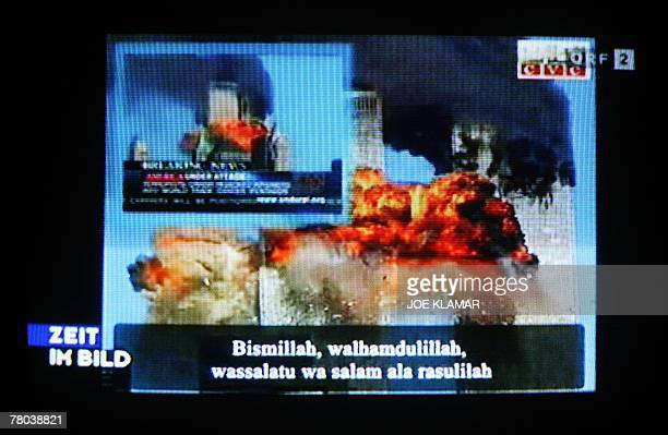 This pictue taken 20 November 2007 in Vienna shows a TV screen featuring a video of Islamist militants identifying themselves as GIMF making internet...