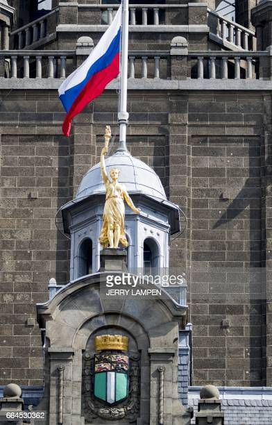 This picture a Russian flag hanging at halfmast in honor to the victims of the blast in the SaintPetersburg metro over the town hall in Rotterdam on...