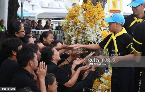 This picture by Thailand's Dailynews shows Prince Dipangkorn Rasmijoti greeting wellwishers in Bangkok on October 25 near the site of where his...