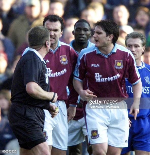 This picture can only be used within the context of an editorial feature As West Ham's Steve Lomas is treated after a clash of heads West Ham players...