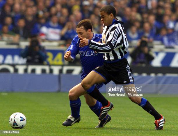This picture can only be used within the context of an editorial feature Newcastle United's Kieron Dyer and Chelsea's Albert Ferrer go for the ball...