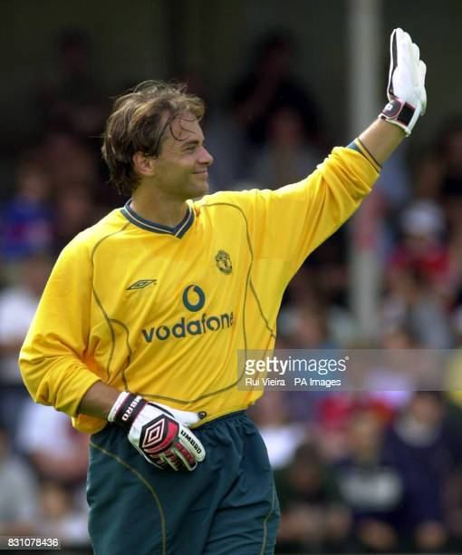 This picture can only be used within the context of an editorial feature Manchester United XI goalkeeper Mark Bosnich waves to the crowd during a...