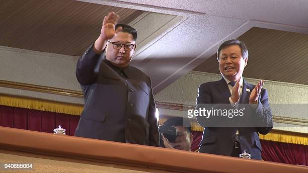 TOPSHOT This picture captured from a video footage by Korea Pool reporters shows North Korean leader Kim Jong Un and South Korea's Culture Sports and...