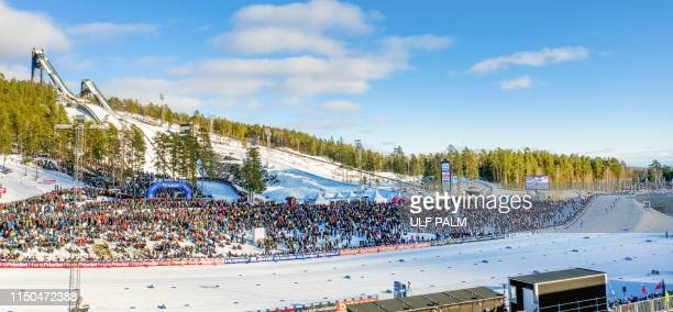 This picture date March 16 shows spectators at the stadium during the Nordic Skiing World hampionships in Falun Sweden The International Olympic...