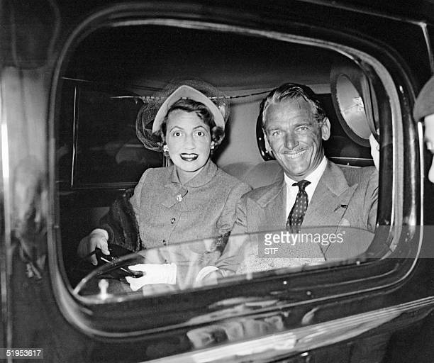 This picture dated 08 September 1948 shows in a car American film star Douglas Fairbanks Junior, then a UN diplomat, after arriving with his wife at...