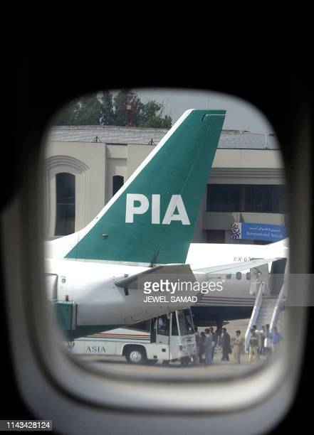 This picture dated 09 July 2003 shows a view through an aircraft window of a Boeing 747 tail fin of an aircraft of Pakistan International Airlines...