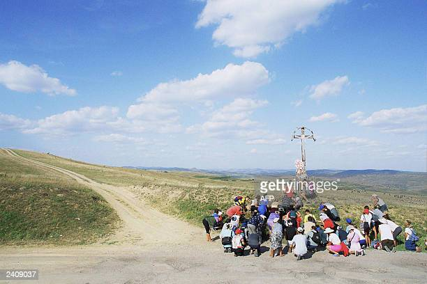 This picture dated 13 August 2003 shows some 50 farmers praying as they leave Desida a village situated 200 kilometers from church of Nicula People...