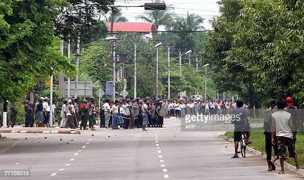 This picture dated 27 September, 2007 shows Myanmar soldiers trying to chase protesters in downtown Yangon. China's Premier Wen Jiabao 29 September,...