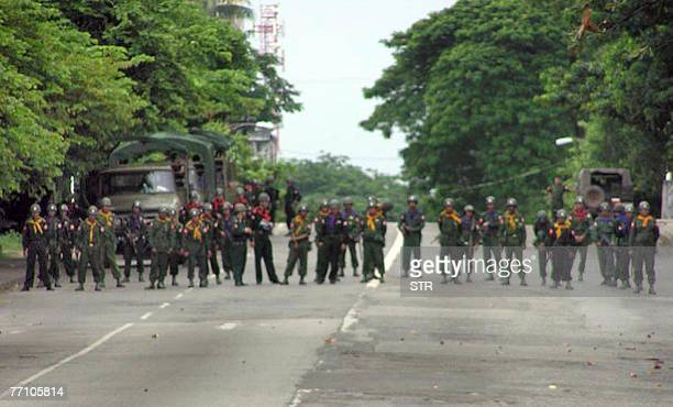 This picture dated 28 September, 2007 shows Myanmar soldiers blocking a street in downtown Yangon. China's Premier Wen Jiabao 29 September, 2007 has...