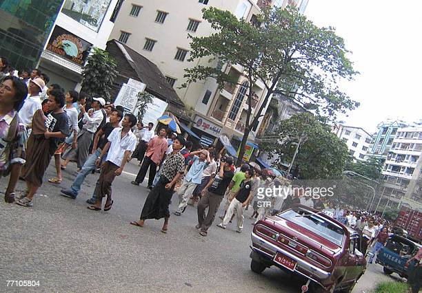 This picture dated 28 September, 2007 shows people marching in downtown Yangon. China's Premier Wen Jiabao 29 September, 2007 has urged Myanmar to...