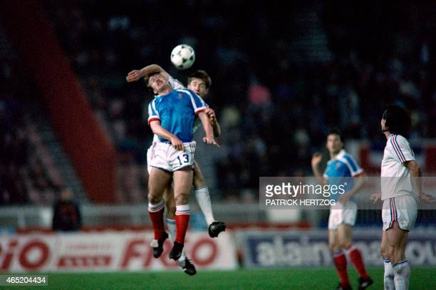 This file picture dated 29 April 1989 shows France's Didier Deschamps during his first match with the French national team fighting for a header...