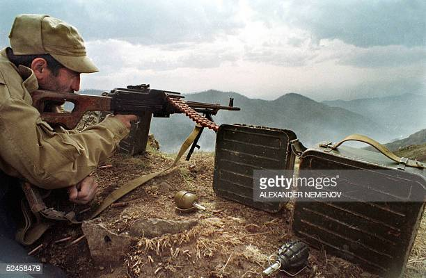 This picture dated April 1993, shows Armenian soldier, aiming at his position at a frontline with Azrbaijan troops not far from the town of Hadrut,...