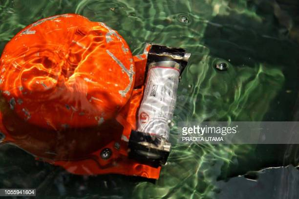 This picture from Indonesia media agency 'detikcom' shows part of the illfated Lion Air flight JT 610's black box an FDR after it was recovered from...