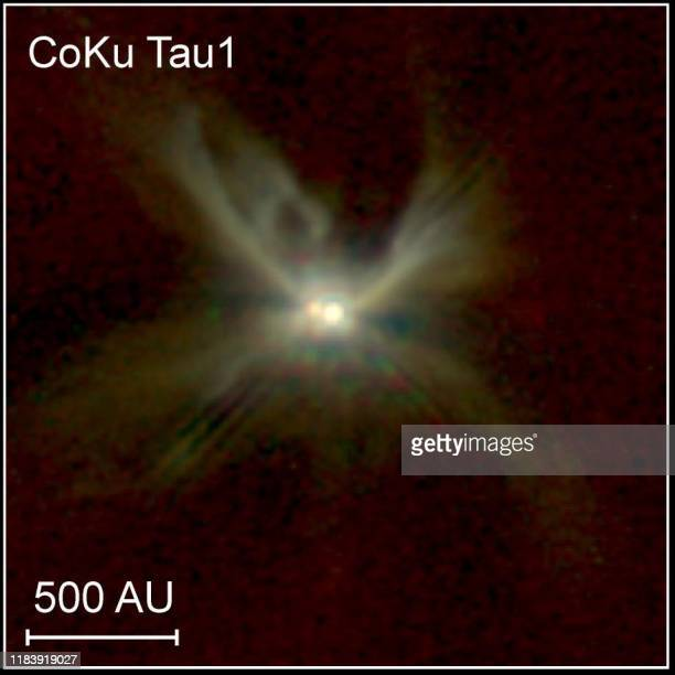 This picture made with the Hubble Space Telescope and released 09 February by NASA shows the newborn binary star system CoKu Tau/1 The star lies at...
