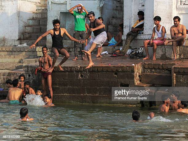 This picture of men jumping in to the river Ganges at Manikarnika bathing ghat in Varanasi was taken on 9.6.2013.