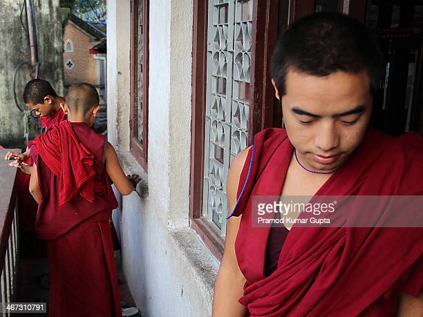 This picture of young monks coming out of the prayer room was taken on at a monastery near Swayambhu temple in Kathmandu, Nepal