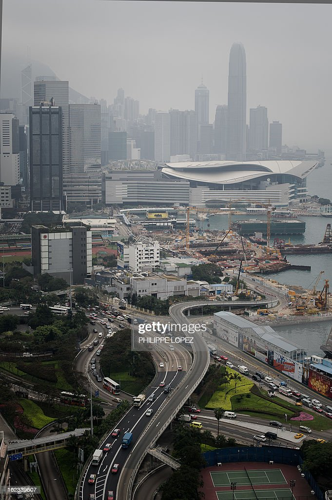 This picture on February 21, 2013 shows highways and high rise buildings in Hong Kong. Hong Kong unveiled fresh measures on February 22, 2013 to cool its ever red-hot property market, as the finance minister warned that an asset bubble is forming in the southern Chinese city. AFP PHOTO / Philippe Lopez