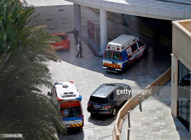 This picture picture taken on February 28 2020 shows ambulances on the scene at the Crowne Plaza hotel at Yas Island Abu Dhabi where two Italian...