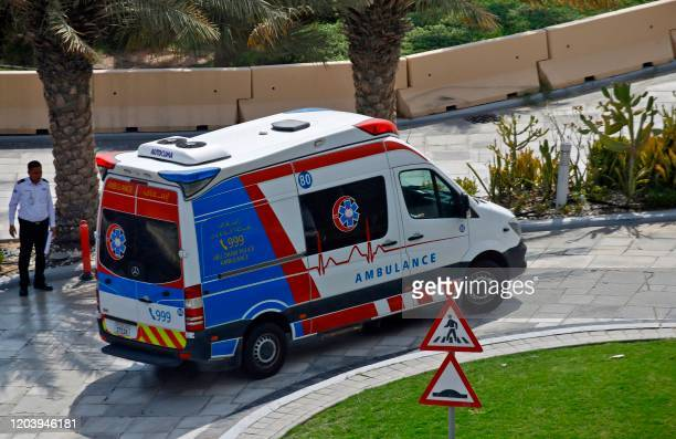 This picture picture taken on February 28 2020 shows an ambulance on the scene at the Crowne Plaza hotel at Yas Island Abu Dhabi where two Italian...