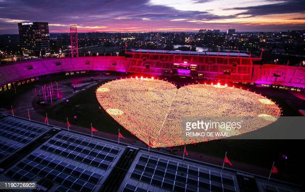 This picture shopws thousands of lanterns lit inside the Olympic Stadium in Amsterdam during the fourth edition of the lantern campaign by Dutch KWF...
