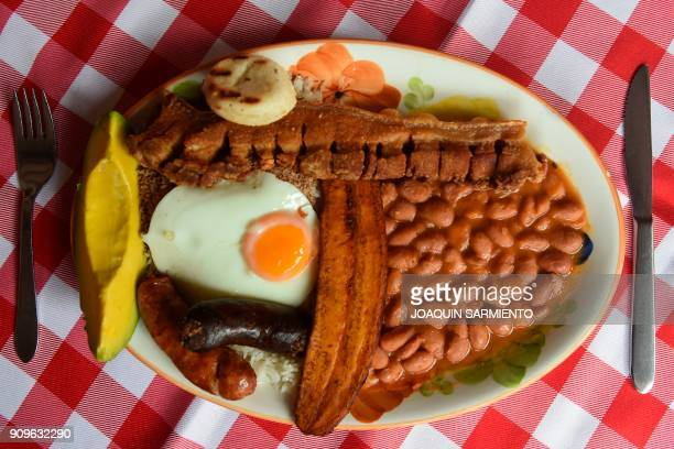 This picture shows a Bandeja Paisa at a restaurant in Medellin Antioquia department on January 22 2018 The Bandeja Paisa is a traditional Colombian...