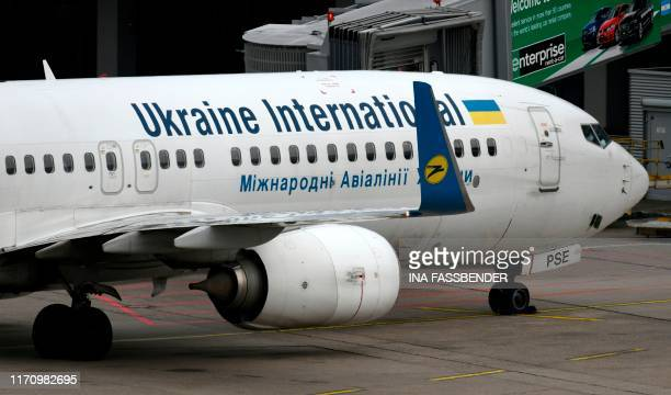 This picture shows a Boeing 737-800 of the Ukraine International airline on September 24, 2019 at the airport in Duesseldorf, western Germany.