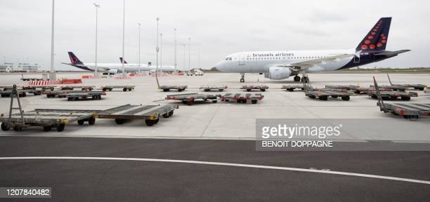 This picture shows a Brussels Airlines A319112 grounded at Brussels Airport after the suspension of more than 60 percent of the flights of Brussels...