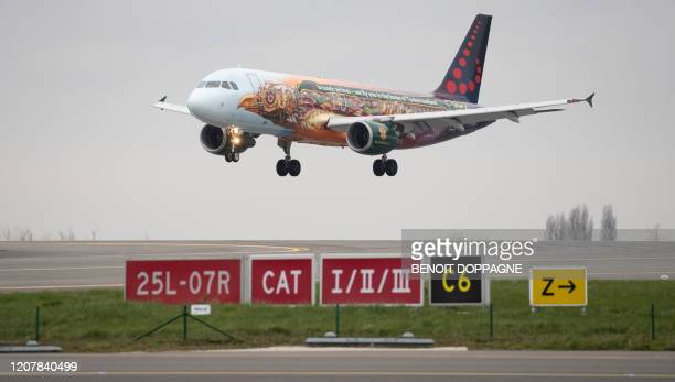 This picture shows a Brussels Airlines plane A320214 the last one to land at Brussels Airport before the suspension of more than 60 percent of the...