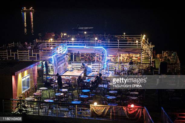 This picture shows a cafe at night on the bank of the Nile river in Khartoum, on June 14, 2019.