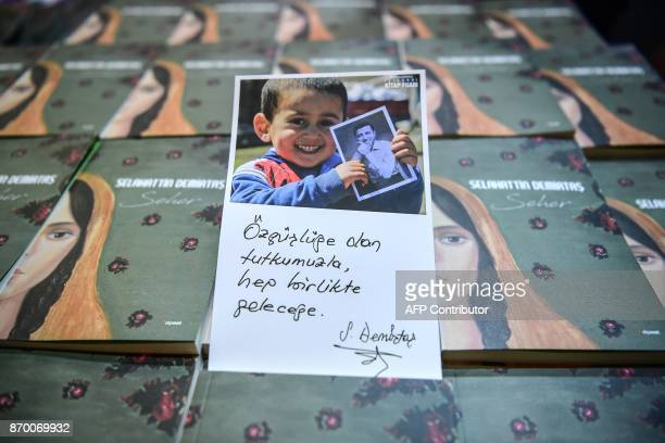 This picture shows a card reading 'All together to future with our passion for freedom' during a symbolic signing of the detained leader of Pro...