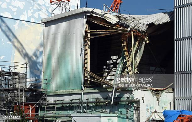 This picture shows a damaged building beside the Unit 3 nuclear reactor building at the Fukushima Daiichi nuclear power plant in Okuma Fukushima...