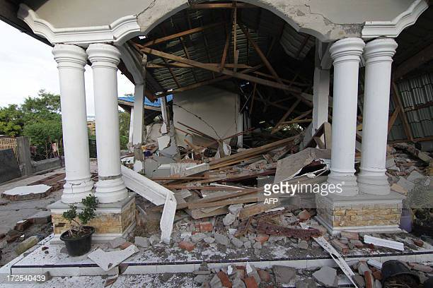 This picture shows a damaged house in Blang Mancung on July 3 2013 following an earthquake on July 2 Rescuers battled through landslides and blocked...
