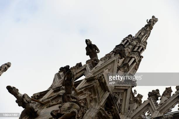 This picture shows a detail of Milan's cathedral the Duomo with its side spires on November 15 in Milan The cathedral of Milan calls citizens around...