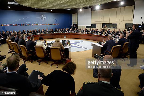 This picture shows a general view after ministers took their seats prior to the start of a NATO Defence meeting at the NATO headquarter in Brussels...