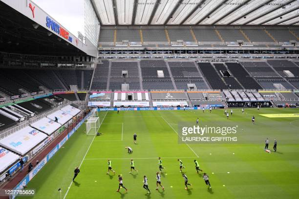 This picture shows a general view inside the stadium as Newcastle United players warm up prior to the English Premier League football match between...