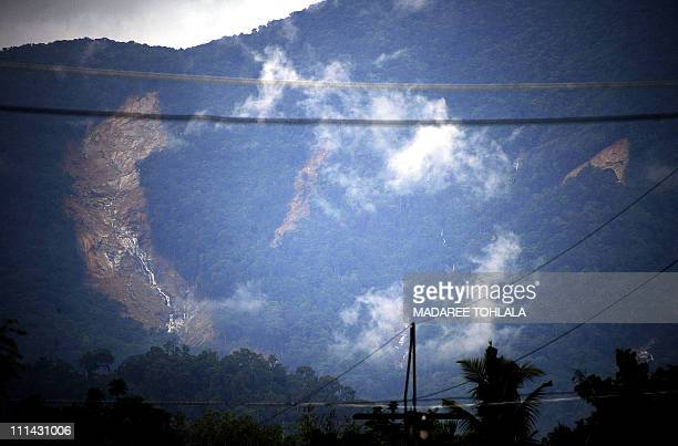 This picture shows a general view of a landslide which struck across the slope of a mountain following torrential rains in Thailand's southern...