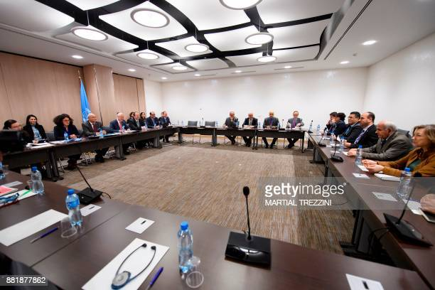 This picture shows a general view of a meeting between Syria's main opposition High Negotiations Committee head Nasr alHariri and United Nations...