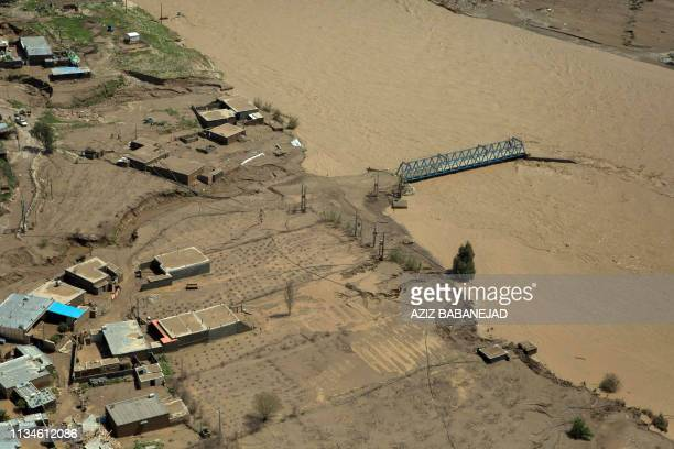 This picture shows a general view of the flooded city of Poldokhtar in the Lorestan province on April 02 2019 Iranian emergency services were bracing...