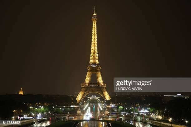 This picture shows a general view of the illuminated Eiffel Tower from the Trocadero Plaza in Paris on September 1 2017