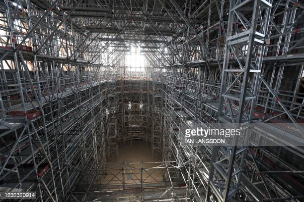This picture shows a general view of the main scaffolding under the vaults of the Notre-Dame de Paris Cathedral ahead of a visit of French President...