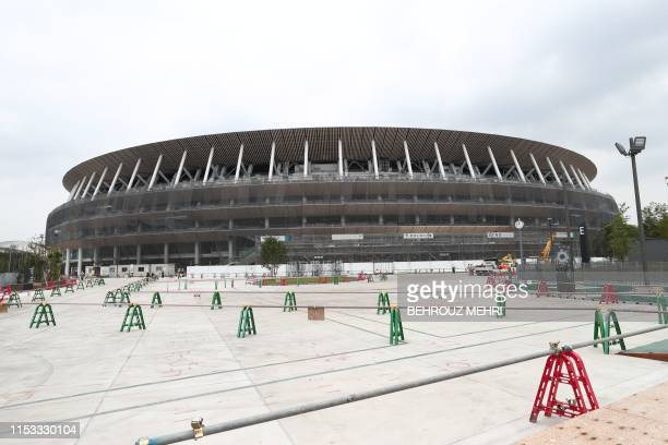 This picture shows a general view of the new National Stadium under construction, a venue for the upcoming Tokyo 2020 Olympic Games, in Tokyo on July...