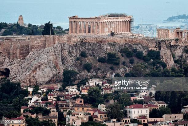 This picture shows a general view of the tiny Anafiotika district of Athens under the Acropolis archaeological site taken on July 10 2018 Climb the...