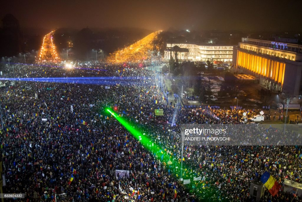 TOPSHOT - This picture shows a large view of people protesting against the Romanian government's contentious corruption decree in front of the government headquarters at the Victoriei square in Bucharest on February 5, 2017. Romania's government formally repealed contentious corruption legislation that has sparked the biggest protests since the fall of dictator Nicolae Ceausescu in 1989, ministerial sources said. The emergency decree, announced on Tuesday (January 31, 2017), would have decriminalised certain corruption offences, raising concerns in Romania and outside that the government was easing up on fighting graft. Centre-right President Klaus Iohannis, elected in 2014 on an anti-graft platform, previously had called the decree 'scandalous' and moved to invoke the constitutional court. / AFP / ANDREI