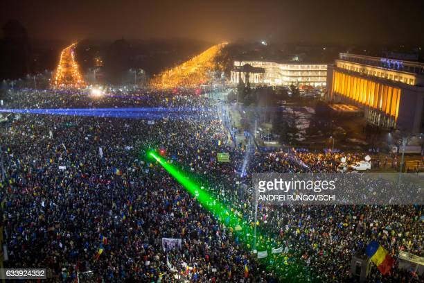 TOPSHOT This picture shows a large view of people protesting against the Romanian government's contentious corruption decree in front of the...