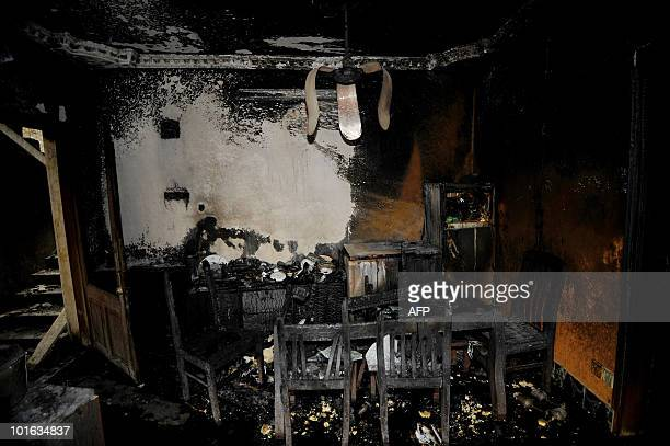 This picture shows a living room at the site of a burntout house in Old Dhaka on June 5 2010 The national flag flew at halfmast and people of all...