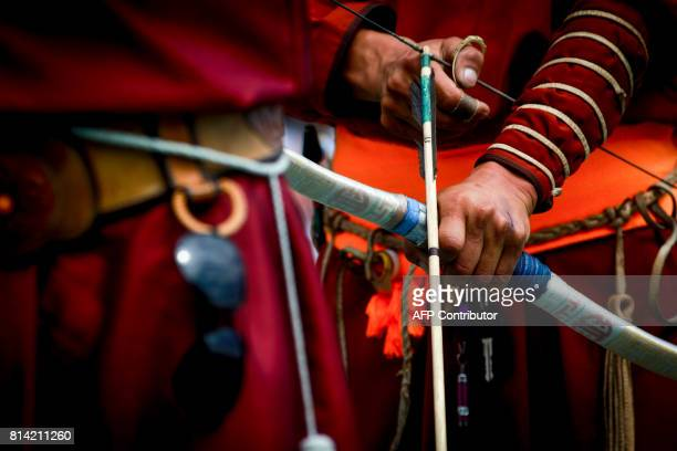 This picture shows a man holding a bow and arrow during the traditional Nadaam festival in Ulan Bator on July 12 2017 The festivities consist of a...